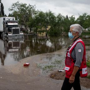 July 28, 2020. Edcouch, Texas Carol Holm of the American Red Cross surveys flooding caused by Hurricane Hanna, in Edcouch, TX on Tuesday July 28, 2020. Photo by Scott Dalton/American Red Cross